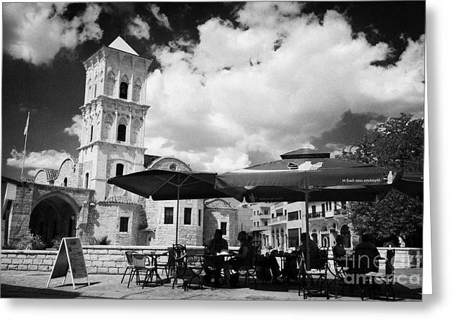 onstreet cafes at St Lazarus Church with belfry larnaca republic of cyprus europe Greeting Card by Joe Fox