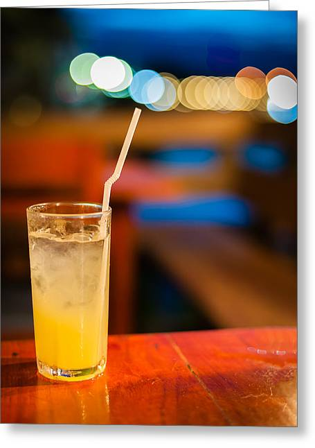 Orange Juice On Table Wilth Color Of Light Greeting Card by Kittipan Boonsopit