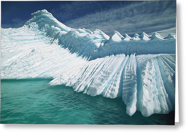Overturned Iceberg With Eroded Edges Greeting Card by Colin Monteath