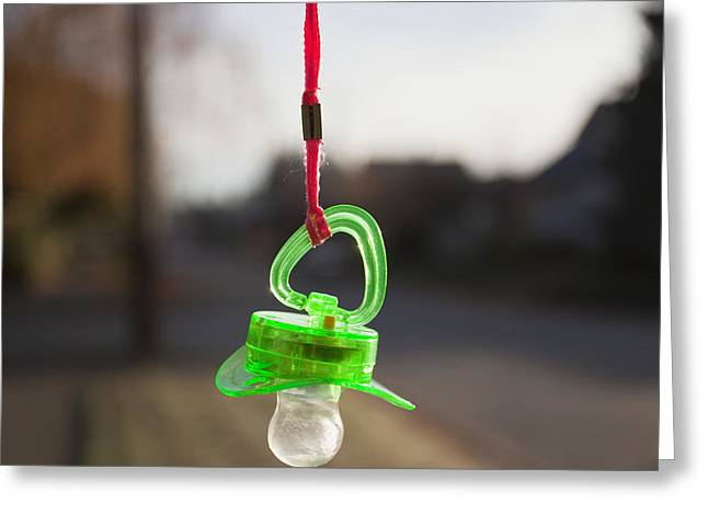 Pacifier Hanging From A Cord Outdoors Greeting Card by Paul Edmondson