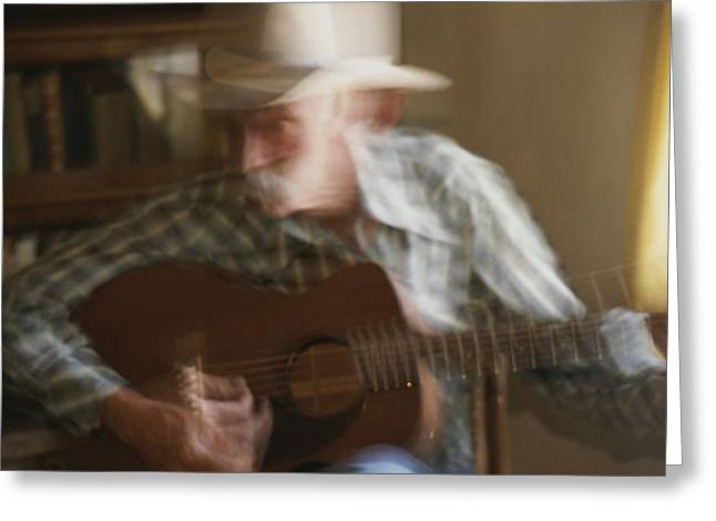 Panned View Of A Cowboy  Playing Greeting Card by Stacy Gold