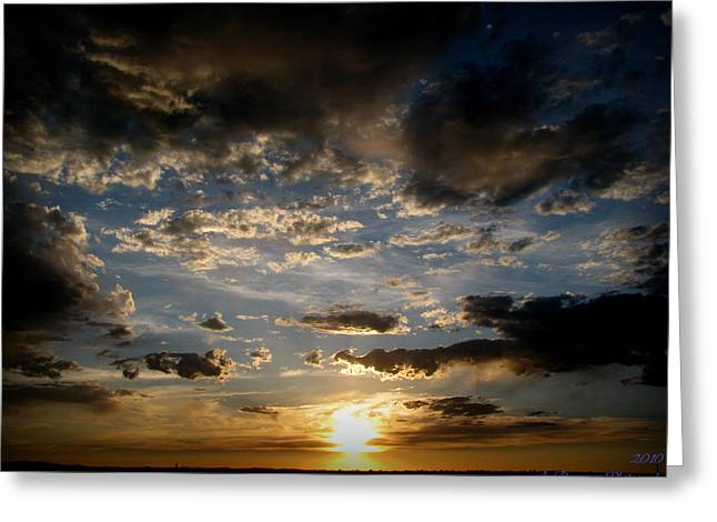 Partly Cloudy Skies At Sunset Greeting Card by Aaron Burrows