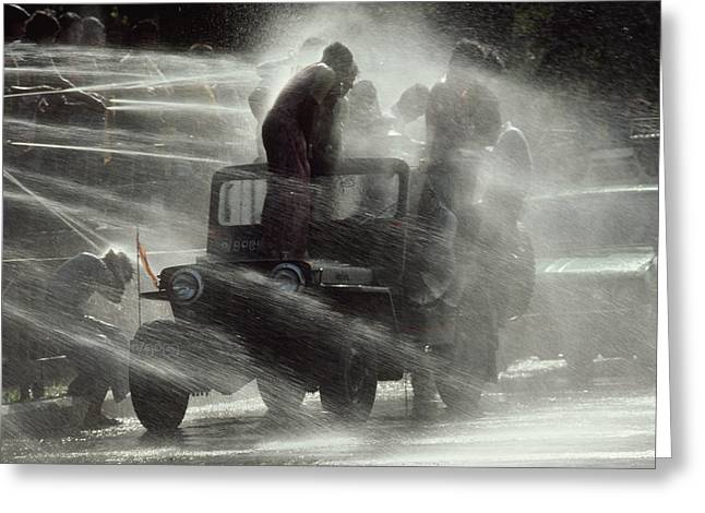 People Are Sprayed At The Water Greeting Card by James L. Stanfield