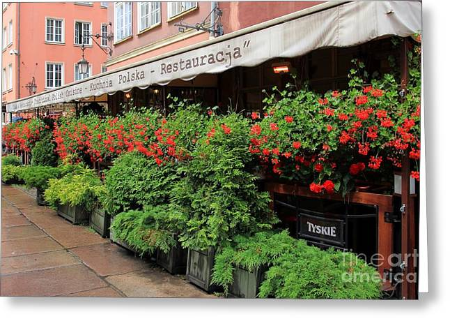 picturesque restaurant terrace in Gdansk Poland Greeting Card by Sophie Vigneault