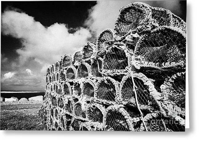 Pile Of Lobster Pots Stacked In The West Coast Of Ireland Greeting Card by Joe Fox