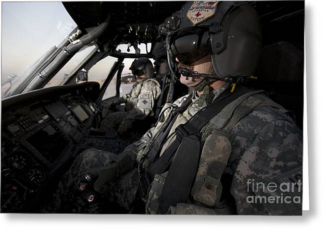Pilot In The Cockpit Of A Uh-60l Greeting Card by Terry Moore