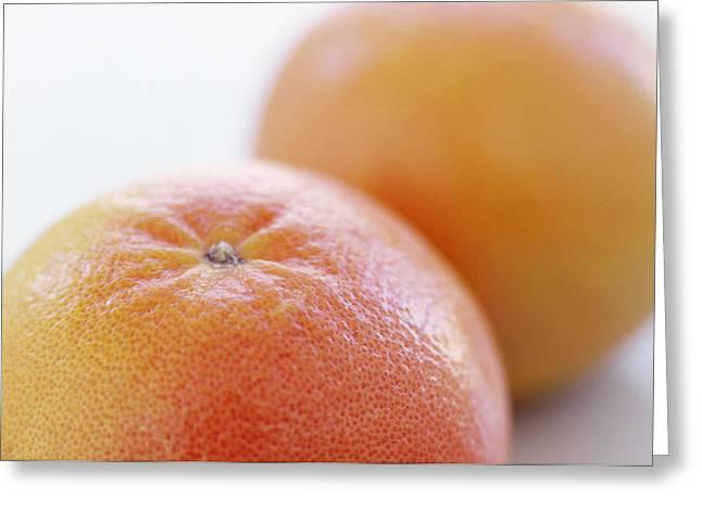 Pink Grapefruits Greeting Card by David Munns