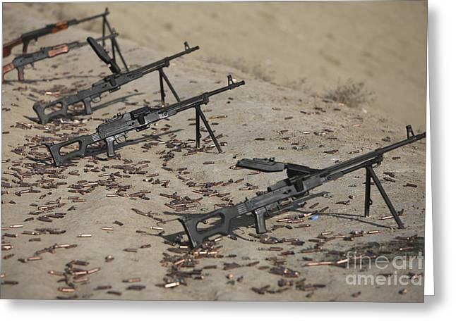 Pk Machine Guns And Spent Cartridges Greeting Card by Terry Moore