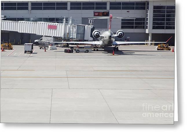 Plane At Gate Greeting Card
