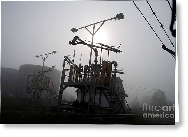 Platforms And Tanks At Petrocor In The Fog Greeting Card by Gary Chapple