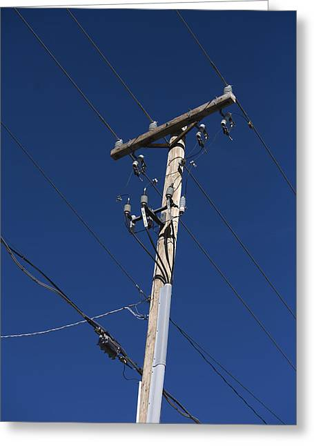 Power Lines Against A Clear Sky Greeting Card by John Burcham