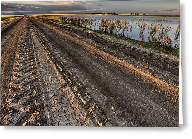 Prairie Road Storm Clouds Mud Tracks Greeting Card by Mark Duffy