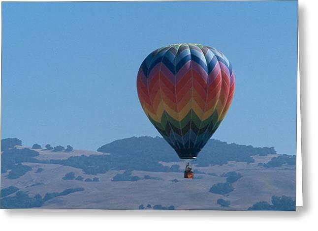 Rainbow Balloon Over Hills Greeting Card