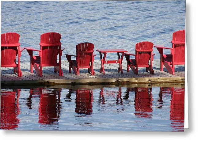 Red Muskoka Chairs Greeting Card by Carolyn Reinhart