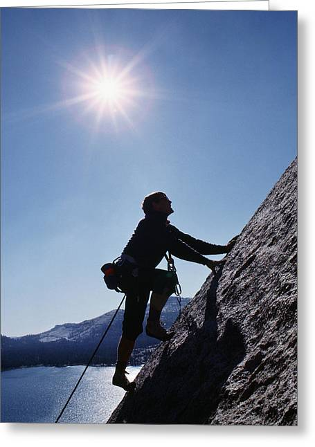 Rock Climber On Polly Dome Above Lake Greeting Card by Gordon Wiltsie