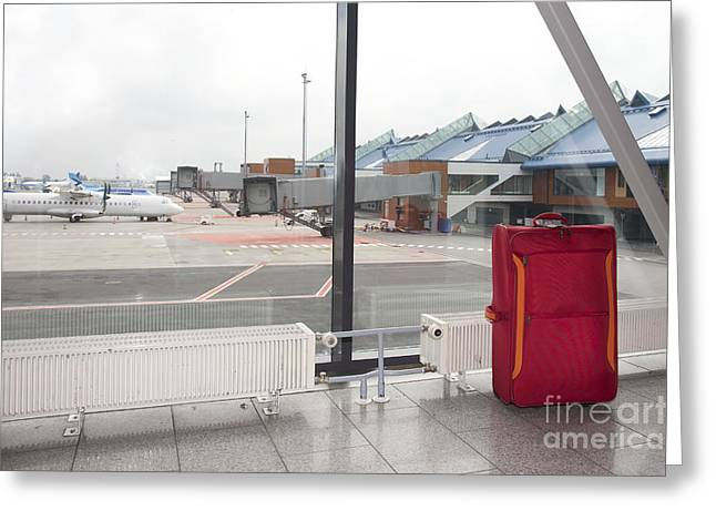 Rolling Luggage In An Airport Concourse Greeting Card by Jaak Nilson