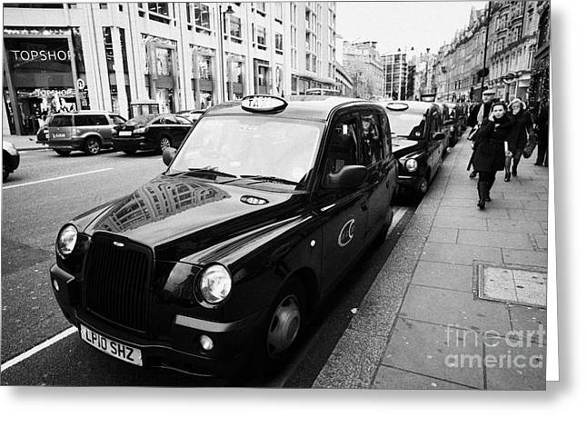 Row Of Black London Cabs Taxis For Hire On Knightsbridge Shopping Street In Central London  Greeting Card