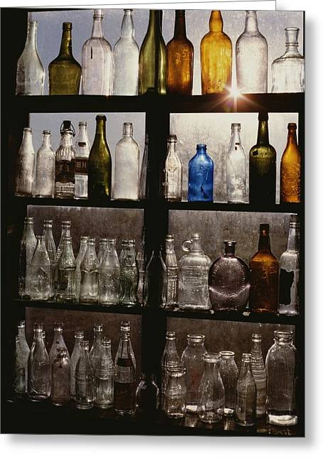 Rows Of Old Bottles In A Greeting Card by Stephen St. John