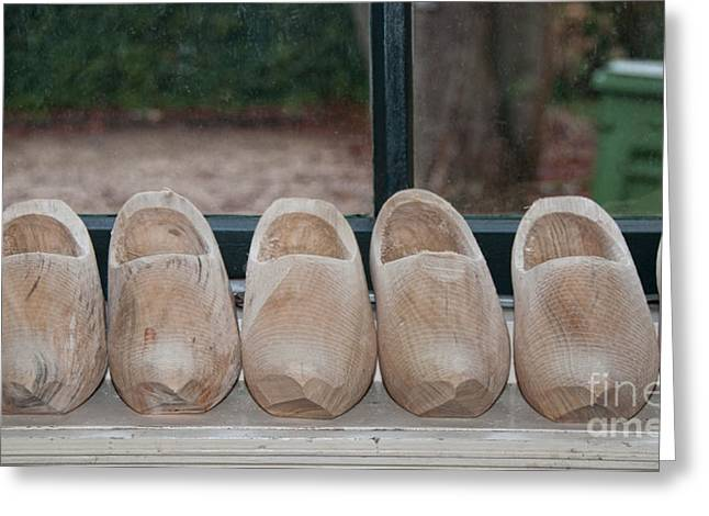Rows Of Wooden Shoes Greeting Card by Carol Ailles
