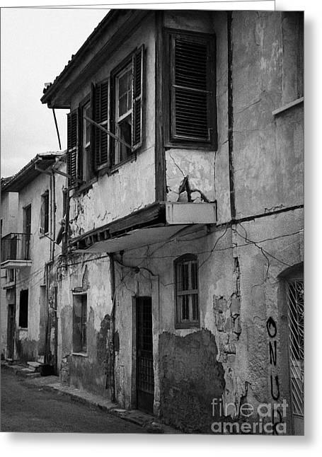 run down building with bay window in the old town of nicosia TRNC turkish republic northern cyprus Greeting Card by Joe Fox