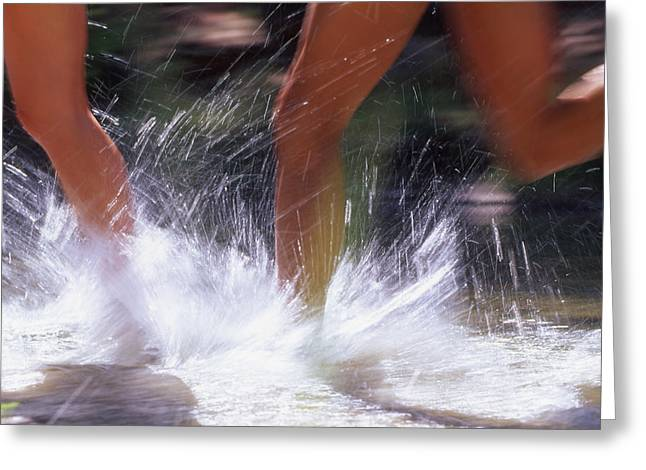 Runners Splashing Through Water Greeting Card