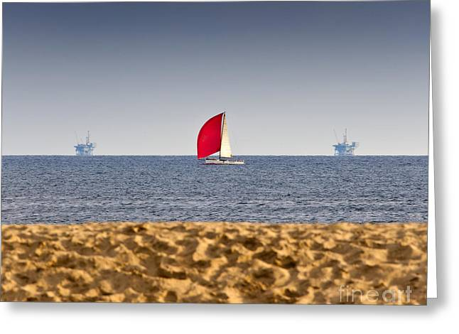 Sailboat And Oil Rigs On The Ocean Greeting Card by David Buffington