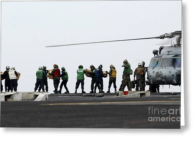 Sailors And Marines Load Supplies Onto Greeting Card by Stocktrek Images
