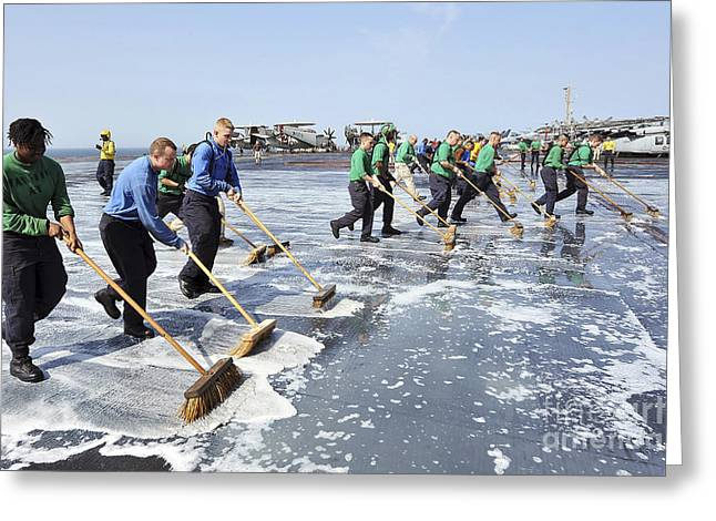 Sailors Scrub Down The Flight Deck Greeting Card by Stocktrek Images