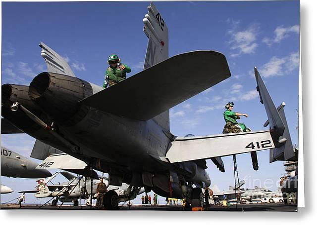 Sailors Wipe Down An Fa-18 Hornet Greeting Card