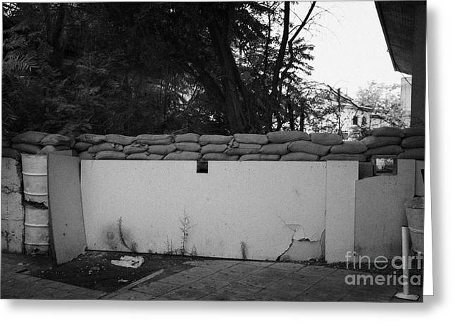 sandbagged wall and firing points across no mans land and restricted area of the UN buffer zone Greeting Card