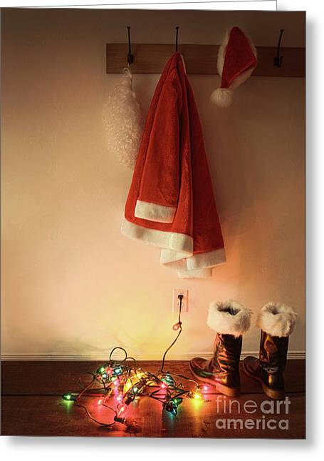 Santa Costume Hanging On Coat Hook With Christmas Lights Greeting Card