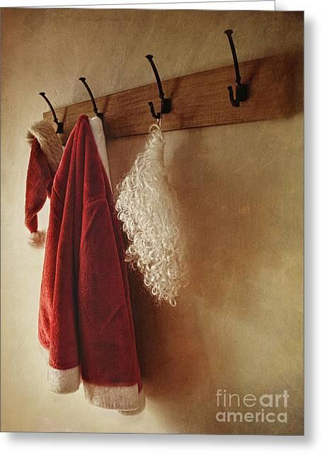 Santa Costume Hanging On Coat Rack Greeting Card