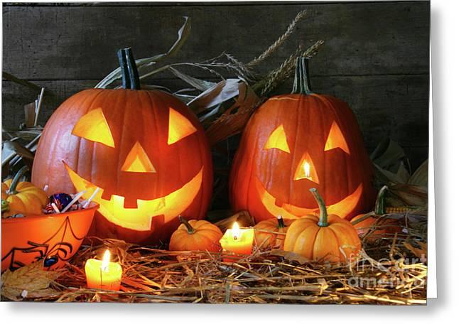 Scarved Jack-o-lanterns  Greeting Card by Sandra Cunningham