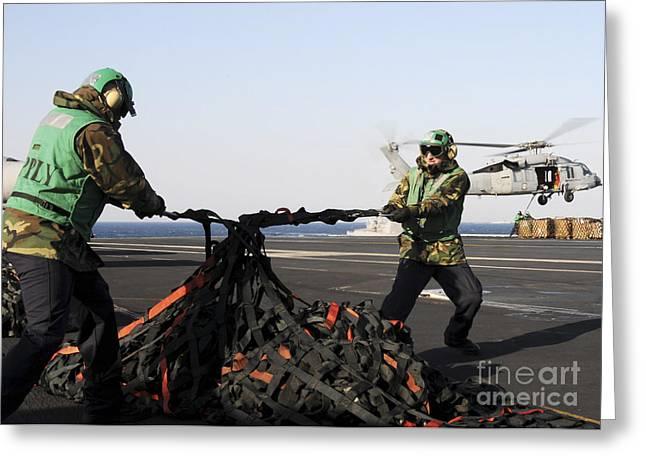 Seamen Tighten A Bundle Of Cargo Nets Greeting Card by Stocktrek Images