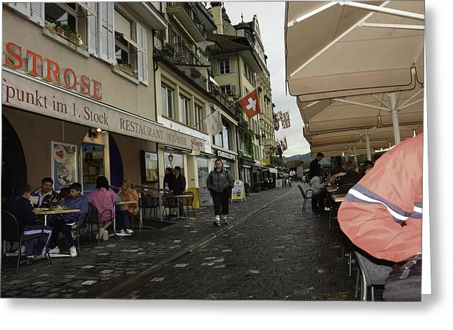 Seated In The Cafe Along The River In Lucerne In Switzerland Greeting Card by Ashish Agarwal