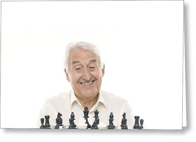 Senior Man Playing Chess Greeting Card