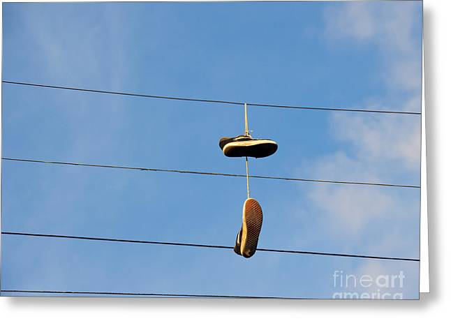 Shoes Hanging From Power Line Greeting Card by David Buffington