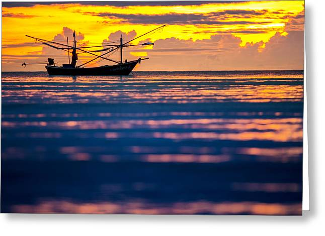 Silhouette Boat At Sea Greeting Card by Arthit Somsakul