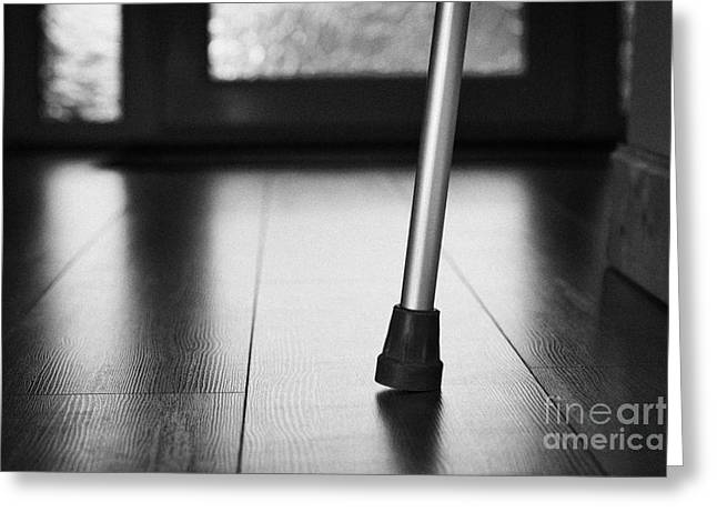 Single Crutch Leg Leaning Against A Wall In A House In The Uk Greeting Card by Joe Fox