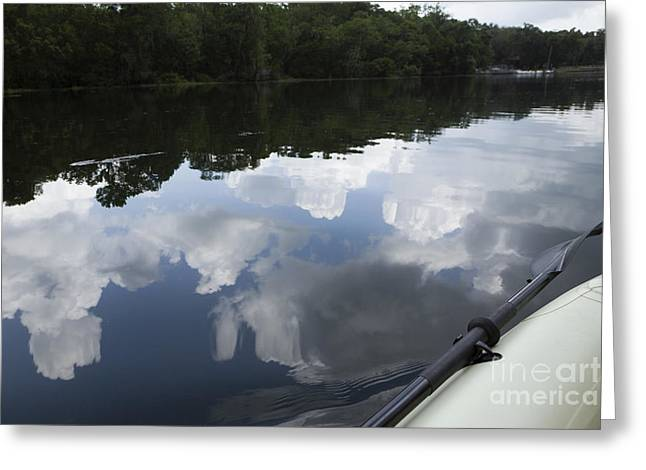 Sky And Clouds Reflected In River Greeting Card by Roberto Westbrook