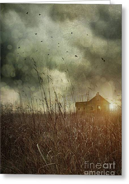Small Abandoned Farm House With Storm Clouds In Field Greeting Card