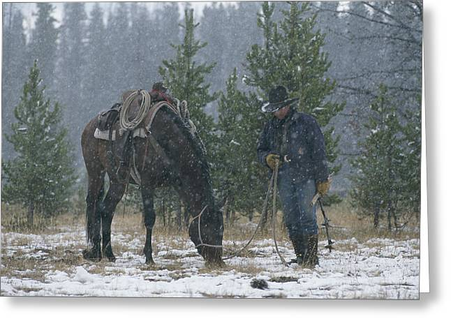 Snow Falls On A Cowboy And His Horse Greeting Card