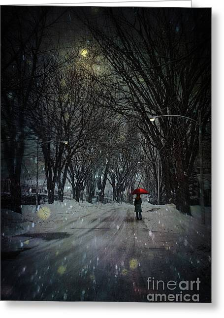 Snowy Winter Scene With Woman Walking At Night Greeting Card by Sandra Cunningham