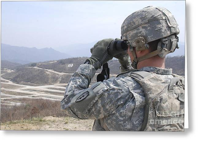 Soldier Observes An Adjust Fire Mission Greeting Card by Stocktrek Images