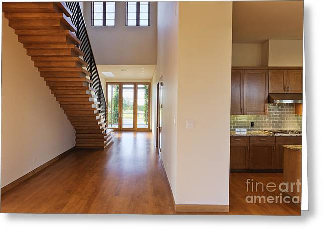 Spacious Hallway Showing A Staircase And Modern Kitchen Greeting Card
