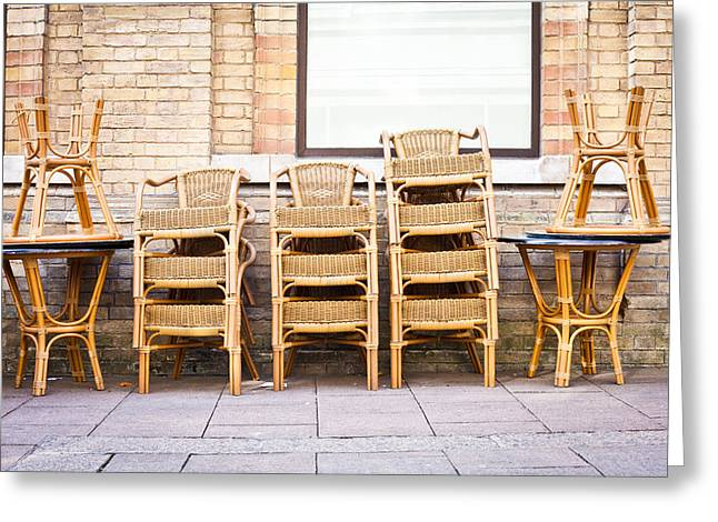 Stacked Chairs Greeting Card by Tom Gowanlock