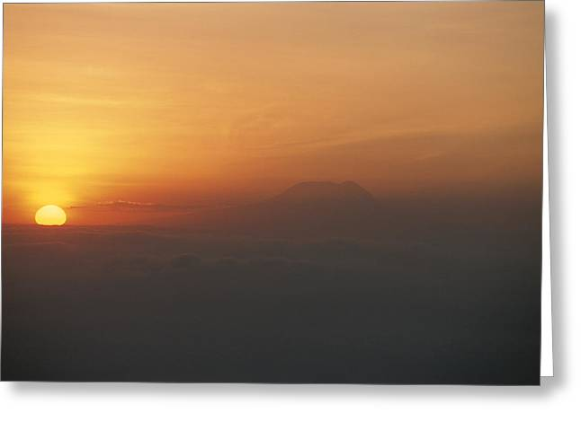 Sun Sets Over Mount Kilimanjaro, Seen Greeting Card by Carsten Peter