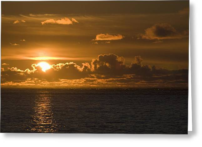 Sun Setting On The Ocean With The Greeting Card by Michael Interisano