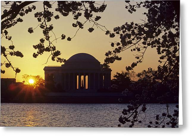 Sun Setting Over The Jefferson Memorial Greeting Card by Kenneth Garrett