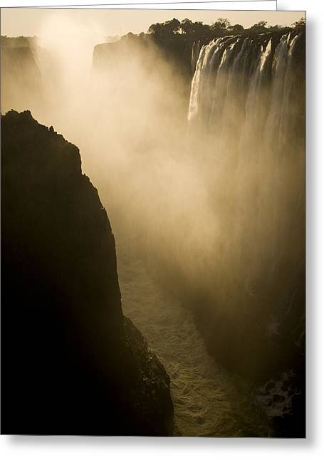 Sunlight Illuminates Mist Rising Greeting Card by Ralph Lee Hopkins